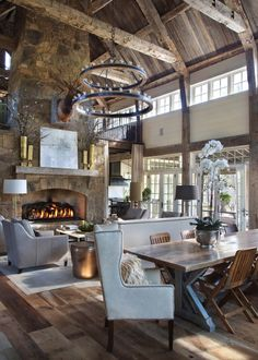 With ceilings and a massive central fireplace, Teresa had difficulty finding a ceiling fixture that could stand up to the scale of the room. Sweet Home, Home Decor Accessories, Cheap Home Decor, Home Interior Design, Modern Cabin Interior, Modern Lodge, Stone Interior, Modern Mountain Home, Modern Rustic Interiors