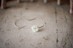 Mini off white flower headband. $6.75, via Etsy.
