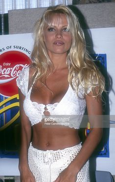 American actress and model Pamela Anderson, who appears in the television show 'Baywatch', attends a press conference to promote the Coca Cola Surf Classic event at Bondi Beach on December 03, 1994 in Sydney, Australia.