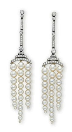 A PAIR OF ART DECO PEARL AND DIAMOND EAR PENDANTS, BY LACLOCHE FRERES   Each suspending three staggered tassels of graduated pearls, from a pierced arched single-cut diamond plaque, to a series of alternating bezel-set old European-cut diamonds and single-cut diamond bar links, mounted in platinum and 18k gold, with French assay marks and maker's marks  Signed Lacloche Frerés, no. 63360