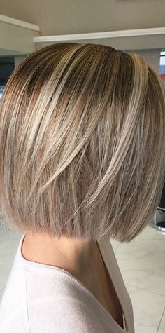 blunt cut with long layers. All hair was cut at one length with a few added long layers to create some extra body.   Point cuts / razor cutting to create a softer rounded edge.  Blow dry with round brush,