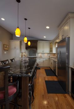Lots of space at this Kitchen Island for long meals and great conversation. #kitchenremodel