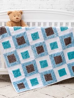 This fun baby quilt features soft, delightful textures, satin binding and a warm flannel backing. Finished size: x Previously published in SIP Quilting Away the Winter Blues Design by Bev Getschel. Annie's Crochet, Crochet Crafts, Baby Quilt Patterns, Baby Warmer, Cool Baby Stuff, Lowercase A, Knitting Yarn, Craft Stores, Warm And Cozy