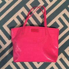 PINK Kate Spade tote Super fun Kate Spade tote...great accents...lots of room to carry things. Pocket on inside as well as two bottle compartments (or could be used in other ways). Note very light marks (two faint marks) on front -- see photo.  The bottom of bag is perfect -- can send additional pic if you'd like. Bag is near mint...only carried a handful of times. kate spade Bags Totes