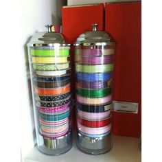 Straw dispenser as ribbon storage. Brilliant! You just have to pull on the top and they all pop up ... you don't even have to undo them ... you can just pull and cut!
