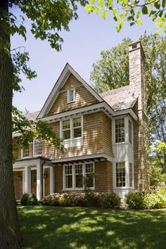 Shingle Style Exterior  - like the mix of exterior finishes, window treatment and window scale - Mockler Taylor Architects