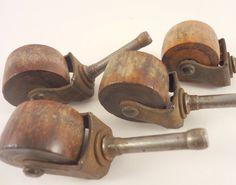 Four Vintage Wood and Metal Furniture Casters, Furniture Wheels. $12.00, via Etsy.