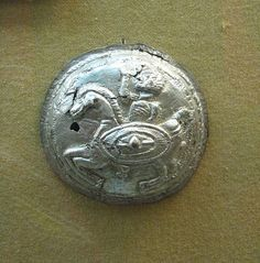 Circular Dacian phalera having the representation of a horseman with shield. Part of the Dacian Silver Hoard of Lupu, 1st century BC. Found at Lupu, Alba, Romania in 1978. It has military and religious significance, being a representation of a God of War, possibly related to the Thracian Rider.