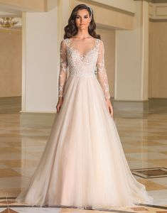 This timeless ball gown look is achieved by the Sabrina neckline, pearl and crystal adorned bodice and illusion sleeves, plunging nude neckline and back, natural waist, and tulle skirt with a chapel length train. Beaded jacket version of the bodice is available as style 8873J.