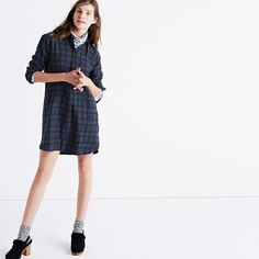 "An easy pop-on shirtdress with buttons at the sides for last-minute leg baring. Made of an appealingly rumpled plaid (it's specially woven for a no-iron-necessary crinkled effect), this one is a timeless boyshirt style in dress form. <ul><li>Nonwaisted.</li><li>Falls 36 1/4"" from highest point of bodice.</li><li>Cotton/wool.</li><li>Hand wash.</li><li>Import.</li></ul>"