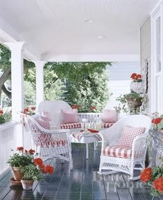 white wicker and red and white gingham. Love the red geraniums with it.