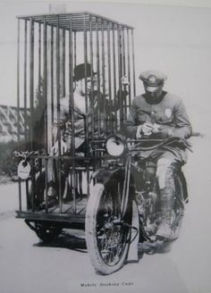 c. 1920s : Harley Davidson Mobile Booking Cage
