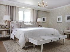 Sarah Richardson:  Hotel chic is the look Sarah was going for in this neutral master bedroom. The multitude of glossy and flat textures punctuates the soft, neutral tones of the space. The lamps accentuate the chandelier's brass frame, while the sleek shapes contrast the chandelier's romantic sparkle. The artwork throughout the space emits an ultimately relaxed feel.