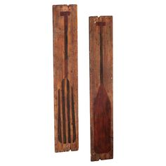 2-piece wood wall decor set with oar motifs.   Product: Set of 2 wall decorConstruction Material: Wood