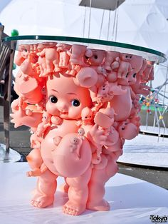 A cute-creepy coffee table made of Kewpie dolls and Kewpie doll parts at the Tokyo Designers Week 2011 event in November of 2011.