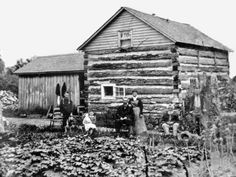 Early farm with log cabin