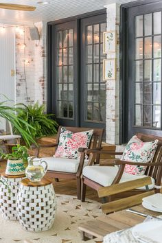 A tropical boho back porch decorated for summer with breezy, functional style from Walmart's Flower Home line by Drew Barrymore and string lights for evening ambience. #backporch #summerdecor