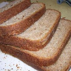 This 100 percent whole wheat loaf from the bread machine is substantial and flavor-packed. Honey Bread, Milk And Honey, Dry Yeast, Bread Baking, Allrecipes, Bread Recipes, Banana Bread, Desserts, Pains