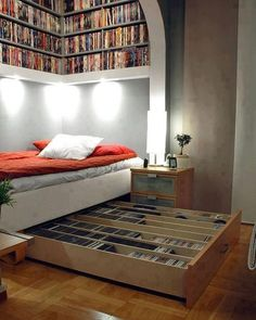 Bedroom with Book Drawer Under Bed and Bookshelves Above