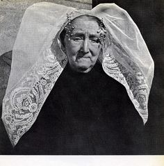 People of the Netherlands , about half a century ago by wvandergroef , yeah it's me, via Flickr civilian clothes from the small place of Axel in the province of Zeeland (Zeeuws-Vlaanderen) in The Netherlands ..... with the dignity of a woman living in a castle ... the wide white veil wrapping round her delicate face ...... #Zeeland #Axel