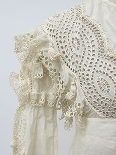 1815–1820 ca.   Dress, Probably British. Sleeve View.  Cotton, linen.  Cutwork bodice on an Empire style high-waisted dress with long sleeves and a wide hem of cutwork.  metmuseum.org              suzilove.com