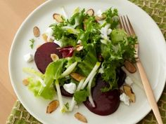 """Roasted Beet Salad : Recipes : Cooking Channel - Man, do I love this salad. Earthy beets with creamy cheese and sweet / tangy greens: so good! If you don't want to make the dressing yourself, I recommend """"Lighthouse Gorgonzola-Pear"""" at the local grocery. Any variety of mixed greens will work well for this- a combo of crunchy romaine hearts, bitter mustard greens and arugala has worked best for me.  Using chopped candied or spiced nuts instead of sliced almonds adds another dimension of…"""