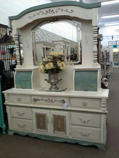 $289 This large 7 drawer dresser has a hutch top with lighted mirror and two roll top compartments; the base has 7 drawers and two doors that open to shelving. Two piece construction for easy moving.  ***** In Booth H12 at Main Street Antique Mall 7260 E Main St (east of Power RD on MAIN STREET) Mesa Az 85207 **** Open 7 days a week 10:00AM-5:30PM **** Call for more information 480 924 1122 **** We Accept cash, debit, VISA, Mastercard, Discover or American Express
