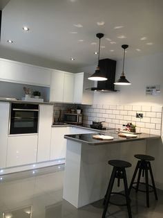New kitchen. Black and white with grey floor tiles.