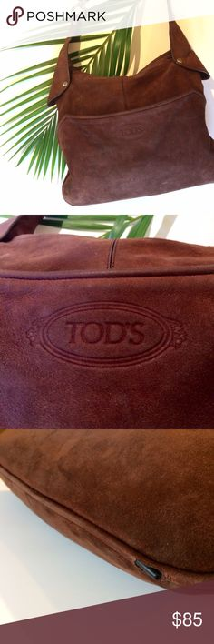 """TOD'S suede bag This gorgeous bag is authentic Tod's. It is a brown suede and the strap is adjustable (with two different snap options, to be worn over the shoulder or Crossbody. It has one main and one side pocket, and a couple internal pockets. Overall is in good used condition, with a few flaws:  small hole at bottom of the bag, where structured piping is protruding about 1/2"""" (in pic 3); minor wear on edge of strap, and zipper pull on side pocket missing (Zipper still functions). Suede…"""