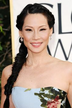 Lucy Liu wore her hair in a messy, fishtail braid, paired with pink lipstick and black eye liner.
