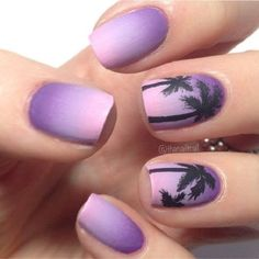 Purple themed Palm Tree Nail Art design. The nails are painted in purple gradient as the palm trees are added in black polish to look like silhouettes. The entire design looks absolutely dreamy.