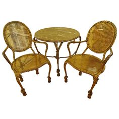 Italian Gilt Iron Round Table and Chairs with Rope and Tassel Motief | From a unique collection of antique and modern dining room sets at https://www.1stdibs.com/furniture/tables/dining-room-sets/