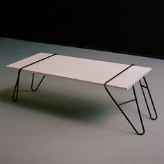 """Leviathan Table by ...  """"These table legs, made from lightweight wire-tubing, gain their stability once connected to the user's tabletop and allow for simple …"""