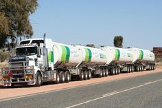 On October 19, 2000, Doug Gould set the first of his records at Kalgoorlie, Western Australia, when a roadtrain made up of 79 trailers, measuring 1,018.2 m (3,341 ft) and weighing 1,072.3 t (1,055.4 long tons; 1,182.0 short tons), was pulled by a Kenworth C501T driven by Steven Matthews a distance of 8 km (5 mi).
