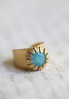 """Blair Antique Indie Stone Ring 22.99.  This gorgeous ring has a brass colored band etched with vertical lines and a wrapped light blue stone in the center. Indie made by MCM designs.  0.5"""" width"""