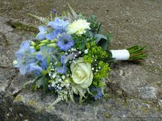 Cool blue handtie bouquet with beautiful blue delphiniums, blue nigella, roses, dahlias, astilbe and alchemilla