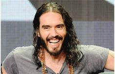 Russell Brand laughing.