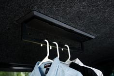 LEER Truck Accessories folding clothes hanger addition to truck cap - great for hanging wet waders etc