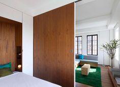 porte coulissante en tant que cloison de votre chambre à coucher moderne