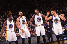 Draymond Green JaVale McGee Kevin Durant and Stephen Curry of the Golden State Warriors talk during the game against the Charlotte Hornets on...