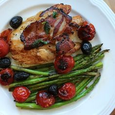 pan-fried chicken with bacon, cherry tomatoes, black olives and basil