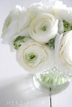ranunculus blooms are available year around ... usually order bulk flowers for delivery 4 days before wedding to allow them to open fully