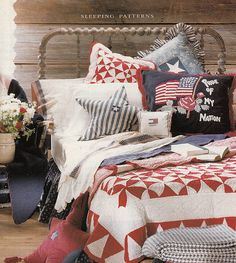 Love the hooked pillow with the flag and the antique quilt in this Patriotic Bedroom