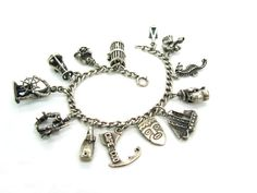Outstanding vintage Cape Cod sterling silver bracelet features an exciting collection of mostly Ella L. Cone charms (see ABOUT below). Each charm