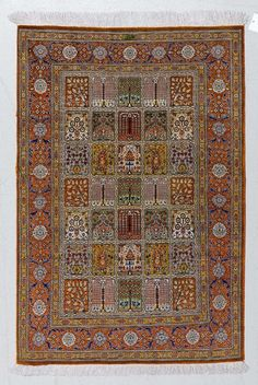 GHOM SILK, GARDEN CARPET.Colourful central field with plant motifs, rust coloured border, in good condition, 80x118cm.