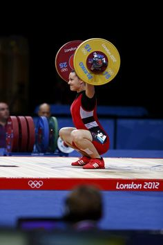 Canada's Christine Girard competes on the women's 63Kg weightlifting competition at the ExCel venue at the London 2012 Olympic Games July 31, 2012. REUTERS/Grigory Dukor (BRITAIN - Tags: SPORT OLYMPICS SPORT WEIGHTLIFTING)