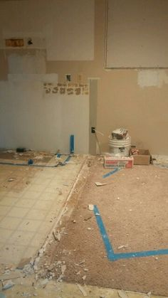 Kitchen,  half wall,  radiator, stove, cabinets all gone