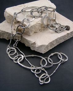 Last month while I was waiting for various kiln loads of steel and bronze metal clay to fire, I decided to make some chain links. I love ma...