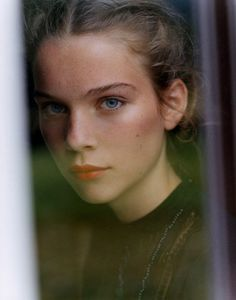 story inspiration, blond hair, blue eyes, red lipstick, slight freckles, through a window