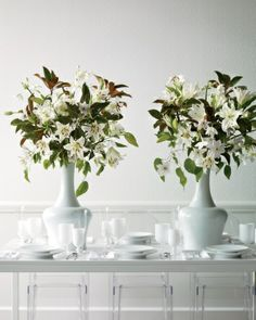 These bursts of 'Casablanca' and eucharis lilies, clematis, and magnolia leaves bring loads of drama and won't get in the way of conversations since they are elevated